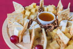 Cheese with grapes, crackers and walnut Stock Images