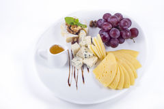 Cheese and grapes Royalty Free Stock Photo