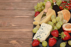 Cheese, grapes and fruit Royalty Free Stock Photography