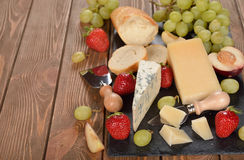 Cheese, grapes and fruit Stock Image