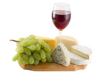 Cheese and grapes with glass  of red wine Stock Photos