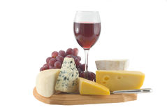 Cheese and grapes with glass of red wine stock photography