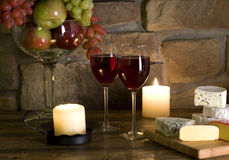 Cheese and grapes with glass  of red wine Royalty Free Stock Images