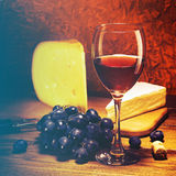 Cheese, grapes and glass of red wine. Royalty Free Stock Photos