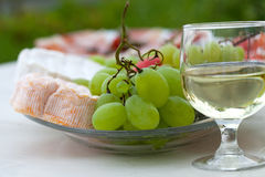 Cheese, grapes and glass of the white wine Royalty Free Stock Image
