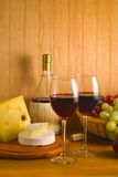 Cheese and grapes with glasses  of red wine Stock Images