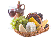 Cheese and grapes with glasses  of red wine Stock Photos