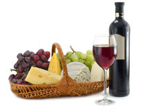 Cheese and grapes with glasses of red wine royalty free stock image