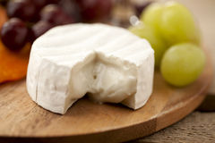 Cheese with grapes Stock Image