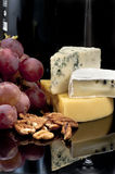 Cheese, grapes and nuts Royalty Free Stock Photography