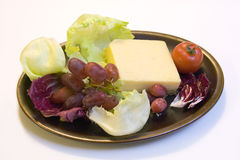 Cheese Grapes & radicchio Stock Images