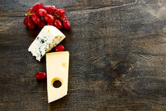 Cheese and grapes Stock Images