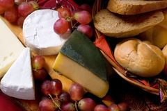 Cheese and grapes, still life Stock Image