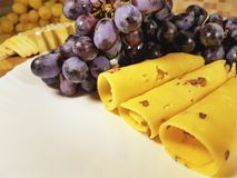 Cheese grapes still life plate nuts royalty free stock image
