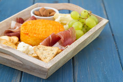 Cheese with grapes, toasts Stock Image