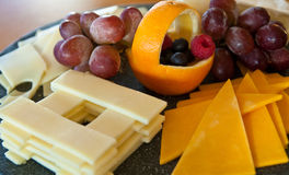 Cheese and Grapes on a Tray Stock Photo