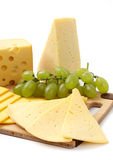 Cheese and grapes on a white background Stock Photography