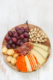Cheese with grapes Royalty Free Stock Image