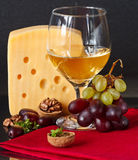 Cheese, grapes, wine. Stock Photography