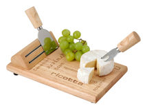 Cheese and grapes on a wooden board Stock Image