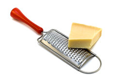 Cheese and grater. Parmesan cheese with grater on a white background Stock Photography