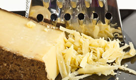 Cheese and grater Stock Image