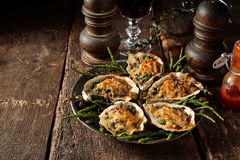 Cheese Gratin Oysters on Rustic Wooden Table stock photography