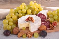 Cheese and green grapes Stock Photo
