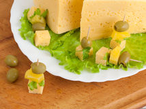 Cheese with greens and olives Royalty Free Stock Photo