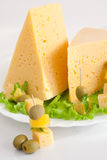 Cheese with greens and olives Stock Photos
