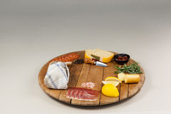 Cheese, ham and bread with various ingredients on chopping board. Against white background Stock Photography