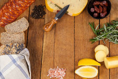 Cheese, ham and bread with various ingredients on chopping board. Close-up of cheese, ham and bread with various ingredients on chopping board Royalty Free Stock Photo