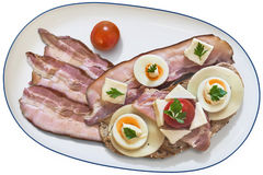 Gourmet Sandwich And Cherry Tomatos Served On Porcelain Platter With Three Extra Bacon Rashers Isolated On White Background Royalty Free Stock Images