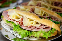 Cheese, ham and salad baguettes. Stock Photos