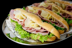 Cheese, ham and salad baguettes. Stock Image