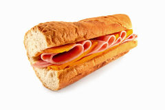 Cheese and Ham Sandwich. A homemade sandwich baguette with two of the most popular fillings ham and cheese, made with freshly baked french bread Stock Photo
