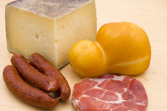 Cheese, ham and sausage Stock Images