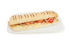 Cheese, ham and tomato pannini Stock Photos