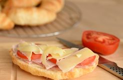 Cheese, Ham and Tomato Topped Croissant. Stock Photography
