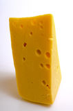 Cheese hard sector. Sector of hard cheese on a light background close-up Royalty Free Stock Photos