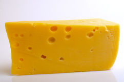 Cheese hard sector. Sector of hard cheese on a light background close-up Royalty Free Stock Images