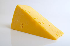 Cheese hard sector. Sector of hard cheese on a light background close-up Stock Photo