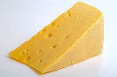 Cheese hard sector. Sector of hard cheese on a light background close-up Stock Photos