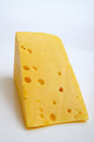 Cheese hard sector. Sector of hard cheese on a light background close-up Stock Photography