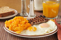 Cheese hash browns with sausage and eggs Stock Images