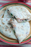 Cheese and herb tortilla. Pita bread stuffed with herbs and cheese Stock Photos