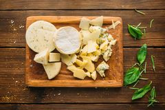 Cheese and herb on wooden table closeup, nobody Royalty Free Stock Photography