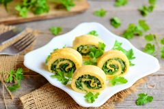 Cheese and herbs omelette rolls on a served plate. Homemade fried omelette rolls with cheese and parsley. Easy egg omelette recipe Royalty Free Stock Photography