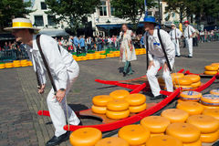 Cheese Holland. ALKMAAR, HOLLAND, THE NETHERLANDS - SEPTEMBER 3: Cheese carriers at the famous Dutch traditional cheese market September 3, 2010 in Alkmaar Stock Photo