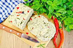 Cheese homemade with hot pepper and knife on board Royalty Free Stock Photos
